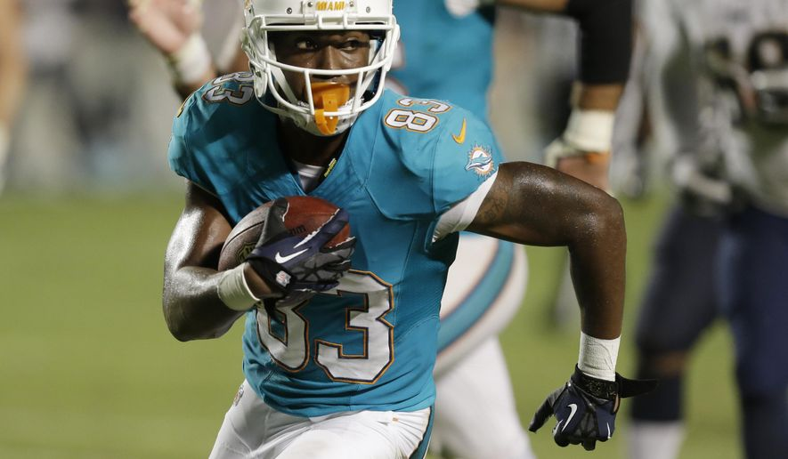 Miami Dolphins wide receiver Matt Hazel runs the ball for a touchdown during the second half of an NFL preseason football game against the St. Louis Rams, Thursday, Aug. 28, 2014 in Miami Gardens, Fla.  (AP Photo/Wilfredo Lee)