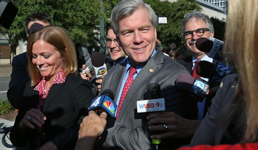 Former Virginia Gov. Bob McDonnell, center, answers reporters' questions as he leaves the Federal Courthouse in Richmond with his daughter Rachel McDonnell, left, Wednesday, Aug. 27, 2014. On the right is one of McDonnell's lawyers, Daniel Small. McDonnell and his wife, Maureen McDonnell, have been on trial under federal corruption charges. (AP Photo/Richmond Times-Dispatch, P. Kevin Morley)