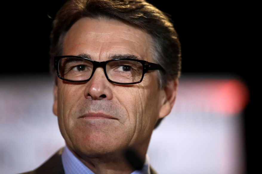 In this Aug. 8, 2014 photo Governor Rick Perry pauses as he addresses attendees at the 2014 Red State convention in Fort Worth, Texas. Two Texans, one White House. Is the 2016 Republican campaign trail big enough? After plummeting from a front-runner to political punchline three years ago, Governor Perry appears poised to run again _ hoping to convince conservatives he can better cope with the national spotlight. (AP Photo/Tony Gutierrez)