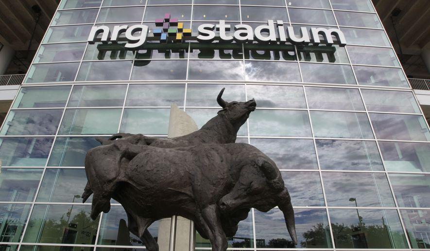 NRG Stadium seen before an NFL football preseason game, Thursday, Aug. 28, 2014, in Houston. (AP Photo/Patric Schneider)