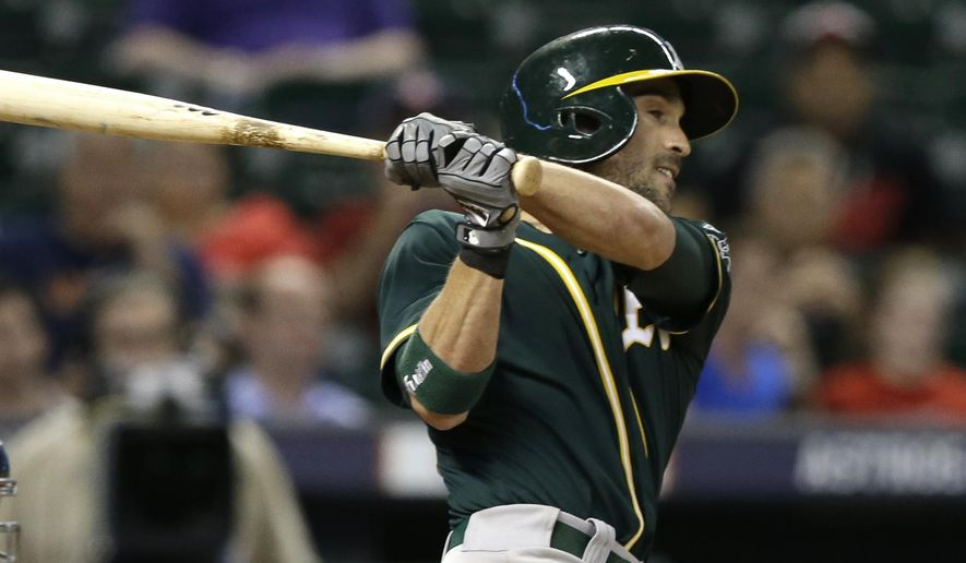 Oakland Athletics' Sam Fuld follows through on a two-run home run against the Houston Astros in the ninth inning of a baseball game Wednesday, Aug. 27, 2014, in Houston. (AP Photo/Pat Sullivan)