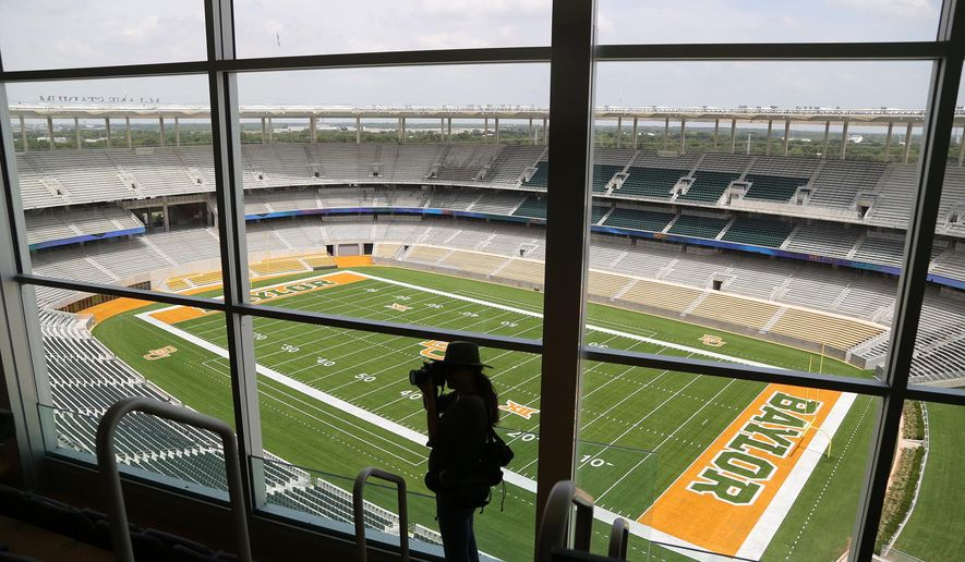 FILE - In this Aug. 18, 2014 file photo, media and visitors tour the nearly completed McLane Stadium during a tour at Baylor University in Waco, Texas. The $260 million stadium located near campus on the Brazos river debuts at the end of the month  and replaces the  64-year-old Floyd Casey Stadium. (AP Photo/Waco Tribune Herald, Rod Aydelotte, File)