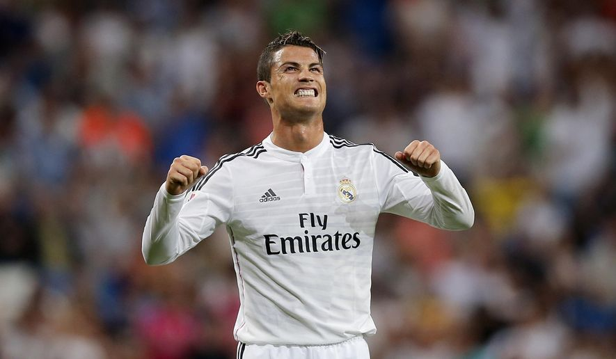 Real Madrid's Cristiano Ronaldo from Portugal celebrates his goal during a Spanish La Liga soccer match between Real Madrid and Cordoba at the Santiago Bernabeu stadium  in Madrid, Spain, Monday, Aug. 25, 2014 . (AP Photo/Daniel Ochoa de Olza)