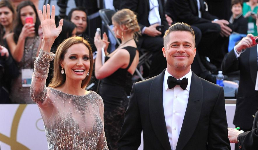 ** FILE ** In this Sunday, March 2, 2014, file photo, Angelina Jolie, left, and Brad Pitt arrive at the Oscars at the Dolby Theatre in Los Angeles. Jolie and Pitt were married Saturday, Aug. 23, 2014, in France, according to a spokesman for the couple. (Photo by Vince Bucci/Invision/AP, File)