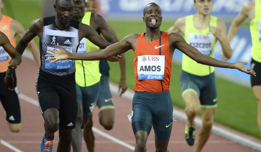Nijel Amos from Botswana celebrates after winning the men's 800m race, during the IAAF Diamond League international athletics meeting in the Letzigrund stadium in Zurich, Switzerland, Thursday, Aug. 28, 2014. (AP Photo/Keystone, Steffen Schmidt)