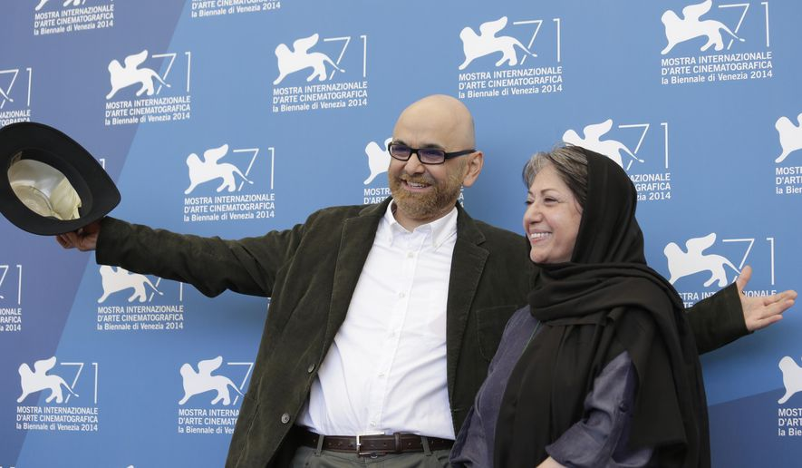 Habib Rezaei and Rakhshan Bani-E'temad pose for photographers at the photo call for the movie Ghesseha during the 71st edition of the Venice Film Festival in Venice, Italy, Thursday, Aug. 28, 2014. (AP Photo/David Azia)