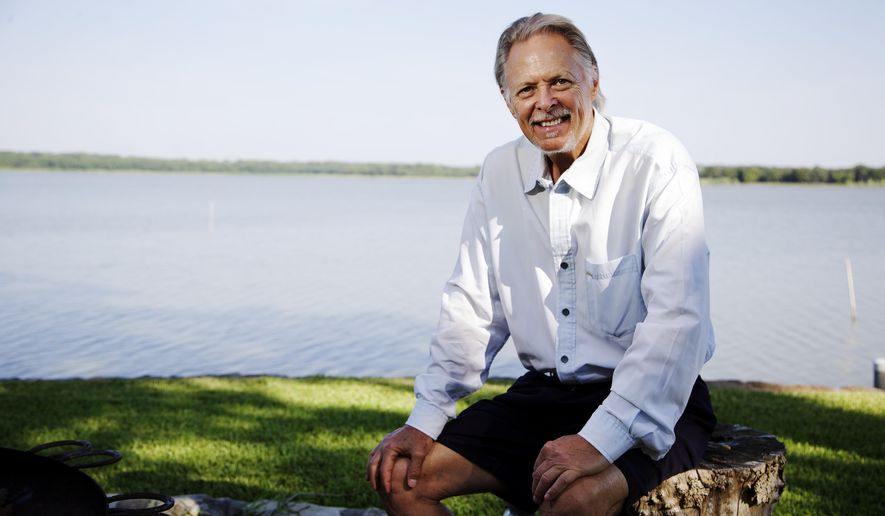 ADVANCE  FOR WEEKEND EDITIONS, AUG. 30-31 - In this photo taken on Aug. 14, 2014, resident and former Lake Worth Alliance President Joe Waller poses for a portrait in his backyard that over looks Lake Worth in Fort Worth, Texas. (AP Photo/The Fort Worth Star-Telegram, Brandon Wade)  MAGS OUT; (FORT WORTH WEEKLY, 360 WEST); INTERNET OUT