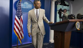 President Barack Obama leaves after speaking about the economy, Iraq, and Ukraine, Thursday, Aug. 28, 2014, in the James Brady Press Briefing Room of the White House in Washington, before convening a meeting with his national security team on the militant threat in Syria and Iraq.  (AP Photo/Evan Vucci)