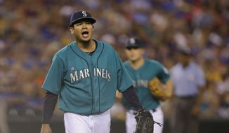 Seattle Mariners starting pitcher Felix Hernandez reacts during a baseball game against the Toronto Blue Jays, Monday, Aug. 11, 2014, in Seattle. (AP Photo/Ted S. Warren)