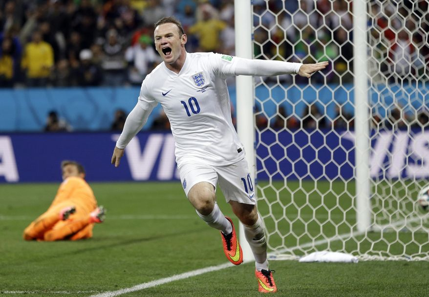 FILE - This is a Thursday, June 19, 2014   file photo of Uruguay's goalkeeper Fernando Muslera looks back as England's Wayne Rooney celebrates after scoring his side's first goal during the group D World Cup soccer match between Uruguay and England at the Itaquerao Stadium in Sao Paulo, Brazil.  Wayne Rooney was named England captain on Thursday, Aug. 28, 2014  taking over the leadership role of an inexperienced team in a rebuilding phase following its worst-ever World Cup. (AP Photo/Kirsty Wigglesworth, File)