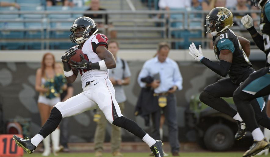 Atlanta Falcons wide receiver Freddie Martino (18) outruns Jacksonville Jaguars cornerback Jeremy Harris (31) and other defenders enroute to a 67-yard touchdown during the first half of an NFL preseason football game in Jacksonville, Fla., Thursday, Aug. 28, 2014. (AP Photo/Phelan M. Ebenhack)