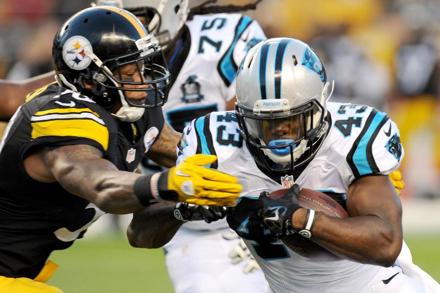 Carolina Panthers running back Fozzy Whittaker (43) is hit by Pittsburgh Steelers outside linebacker Ryan Shazier (50) in the first quarter of the NFL preseason football game on Thursday, Aug. 28, 2014 in Pittsburgh. (AP Photo/Don Wright)