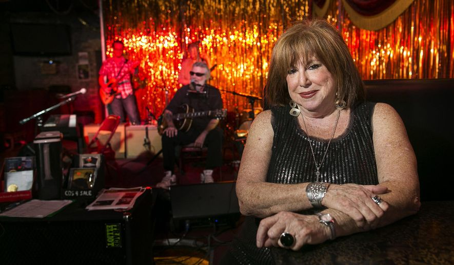 ADVANCE  FOR WEEKEND EDITIONS, AUG. 30-31 - In this photo taken on Aug. 14, 2014, Nancy Coplin, poses for a portrait as blues musician, Paul Oscher, left, performs at C-Boy's Heart & Soul in the SOCO District of Austin, Texas. (AP Photo/Austin American-Statesman, Rodolfo Gonzalez)  AUSTIN CHRONICLE OUT, COMMUNITY IMPACT OUT, INTERNET AND TV MUST CREDIT PHOTOGRAPHER AND STATESMAN.COM, MAGS OUT