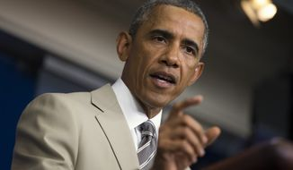 President Barack Obama speaks the economy, Iraq, and Ukraine, Thursday, Aug. 28, 2014, in the James Brady Press Briefing Room of the White House in Washington, before convening a meeting with his national security team on the militant threat in Syria and Iraq. (AP Photo/Evan Vucci)
