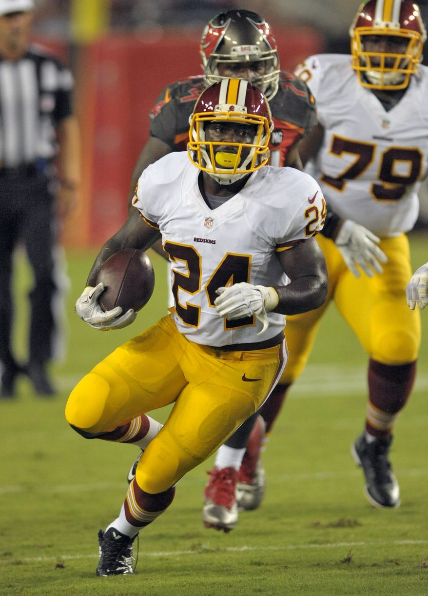 Washington Redskins running back  Silas Redd (24) heads up field after getting past the Tampa Bay Buccaneers defense during the second quarter of an NFL preseason football game Thursday, Aug. 28, 2014, in Tampa, Fla. (AP Photo/Steve Nesius)