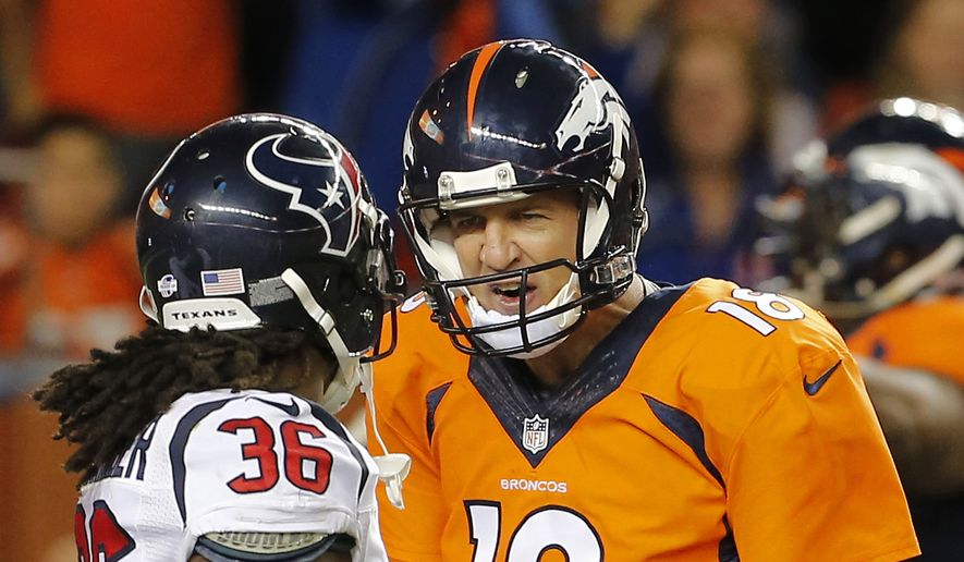 Denver Broncos quarterback Peyton Manning (18) talks to Houston Texans strong safety D.J. Swearinger (36) after a Broncos touchdown during the first half of an NFL preseason football game, Saturday, Aug. 23, 2014, in Denver. Manning was whistled for taunting. (AP Photo/Joe Mahoney)
