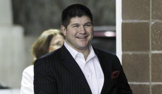 ** FILE ** Jesse Benton, then-campaign manager for Republican presidential candidate, Rep. Ron Paul, R-Texas, arrives at a campaign even in Des Moines, Iowa, Dec. 28, 2011. (Associated Press)