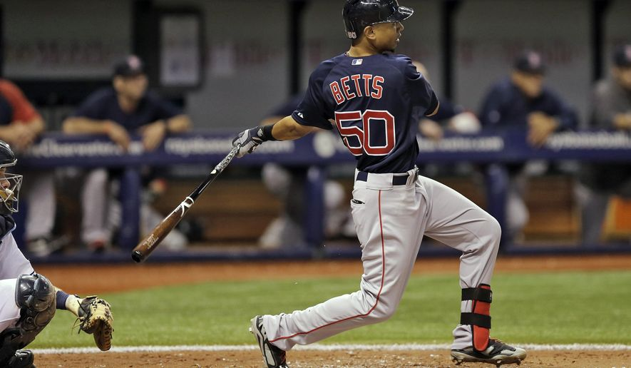 Boston Red Sox's Mookie Betts (50) follows through on a grand slam off Tampa Bay Rays starting pitcher Chris Archer during the second inning of a baseball game Friday, Aug. 29, 2014, in St. Petersburg, Fla. Catching for the Rays is Ryan Hanigan. (AP Photo/Chris O'Meara)