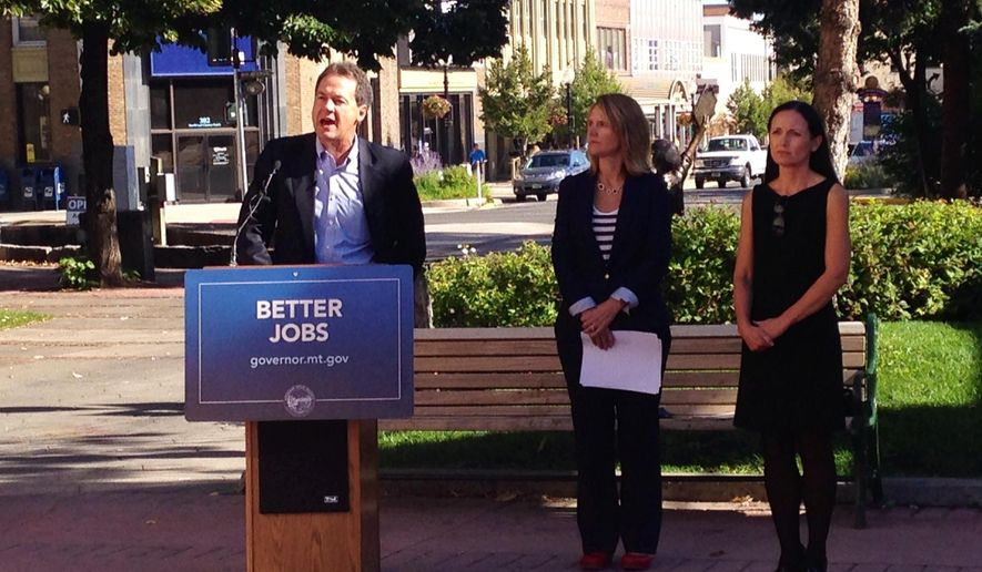 Montana Gov. Steve Bullock presents the Montana Department of Labor and Industry's Labor Day report released Friday, Aug. 29, 2014, in Helena, Mont., while Montana Labor and Industry Commissioner Pam Bucy, center, and Lt. Gov. Angela McLean listen. State officials say Montana ranks in the top five states for employment growth, but it faces slower growth in the future as an aging workforce retires.  (AP Photo/Lisa Baumann)