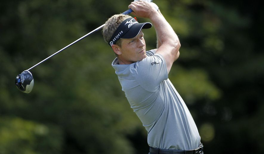 Luke Donald, of England, hits his tee shot on the 14th hole during the first round of the Deutsche Bank Championship golf tournament in Norton, Mass., Friday, Aug. 29, 2014. (AP Photo/Stew Milne)