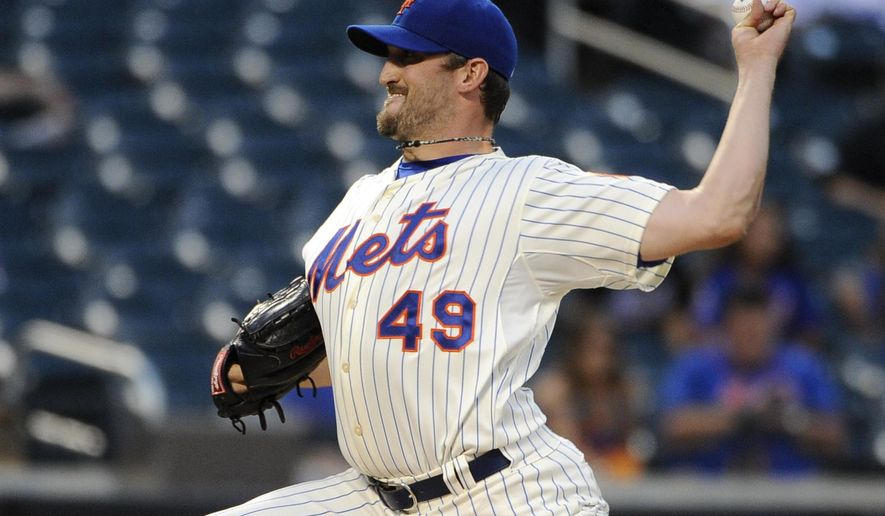 New York Mets starter Jonathon Niese (49) pitches against the Atlanta Braves in the first inning of a baseball game at Citi Field on Thursday, Aug. 28, 2014, in New York. (AP Photo/Kathy Kmonicek)