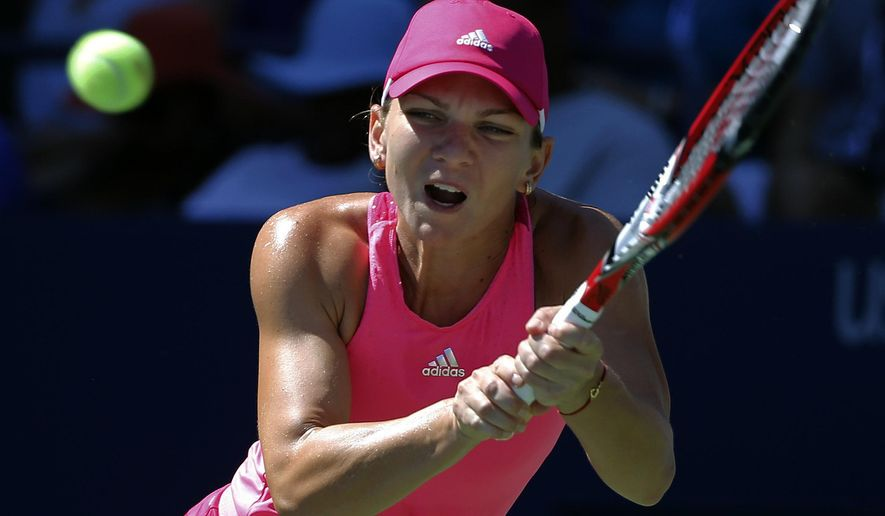 Simona Halep, of Romania, returns a shot against Mirjana Lucic-Baroni, of Croatia, during the third round of the 2014 U.S. Open tennis tournament, Friday, Aug. 29, 2014, in New York. (AP Photo/Elise Amendola)