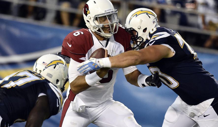 Arizona Cardinals quarterback Logan Thomas, center, is sacked by San Diego Chargers defensive tackle Chas Alecxih, right, during the first half of an NFL preseason football game Thursday, Aug. 28, 2014, in San Diego. (AP Photo/Denis Poroy)