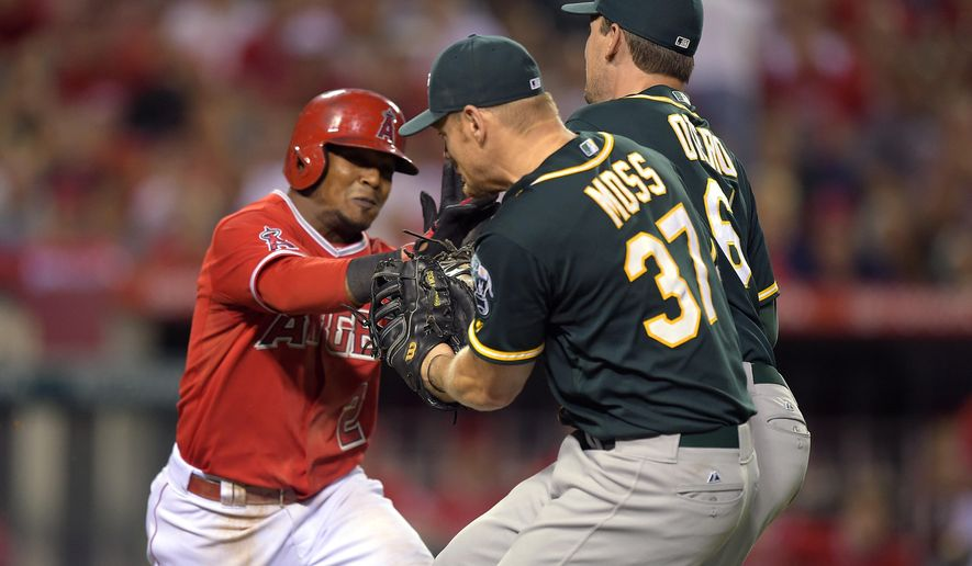 Oakland Athletics relief pitcher Dan Otero, right, appears to tag out Los Angeles Angels' Erick Aybar, left, as Aybar runs to first while Brandon Moss looks on during the ninth inning of a baseball game, Thursday, Aug. 28, 2014, in Anaheim, Calif. Aybar was allowed to advance to first after Dan Otero was called for an error. (AP Photo/Mark J. Terrill)
