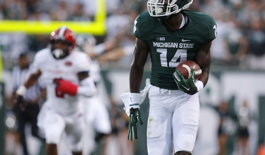 Michigan State's Tony Lippett (14) runs for a touchdown on a 71-yard pass reception against Jacksonville State during the first quarter of an NCAA college football game, Friday, Aug. 29, 2014, in East Lansing, Mich. (AP Photo/Al Goldis)