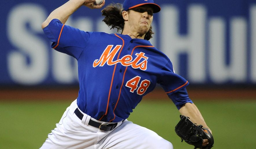 New York Mets starter Jacob deGrom (48) pitches against the Philadelphia Phillies in the first inning of a baseball game at Citi Field on Friday, Aug. 29, 2014, in New York. (AP Photo/Kathy Kmonicek)