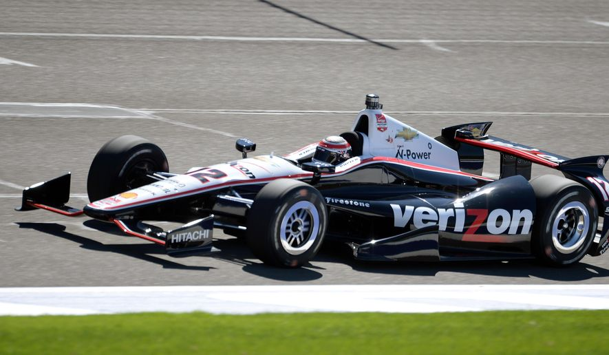 Will Power drives along the front straight during qualifying for the IndyCar series auto race Friday, Aug. 29, 2014, at Auto Club Speedway in Fontana, Calif. (AP Photo/Will Lester)