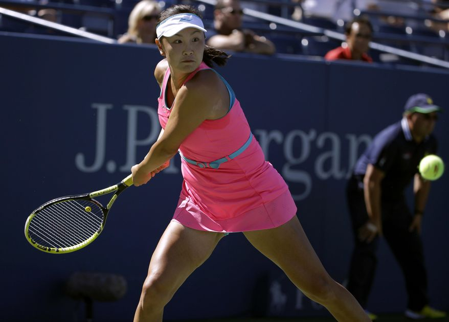 Shuai Peng, of China, returns a shot against Roberta Vinci, of Italy, during the third round  of the 2014 U.S. Open tennis tournament, Friday, Aug. 29, 2014, in New York. (AP Photo/Frank Franklin II)