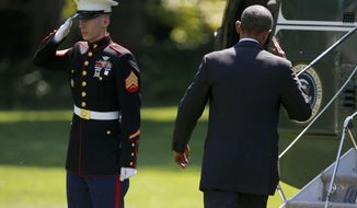 President Barack Obama returns a Marine's salute as he boards Marine One on the South Lawn of the White House in Washington, Friday, Aug. 29, 2014, as he travels to Westchester County, N.Y., and Newport, R.I. (AP Photo/Charles Dharapak)