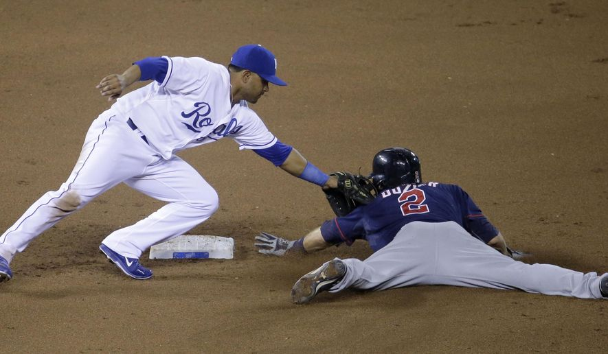 Minnesota Twins' Brian Dozier (2) is caught stealing second by Kansas City Royals second baseman Christian Colon during the ninth inning of a baseball game Thursday, Aug. 28, 2014, in Kansas City, Mo. (AP Photo/Charlie Riedel)