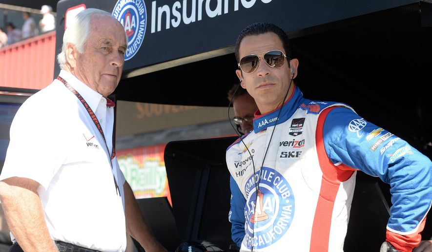 Helio Castroneves, right, stands with team owner Roger Penske prior to practice for Saturday's Indycar auto race Friday, Aug. 29, 2014, at Auto Club Speedway, in Fontana, Calif. (AP Photo/Will Lester)