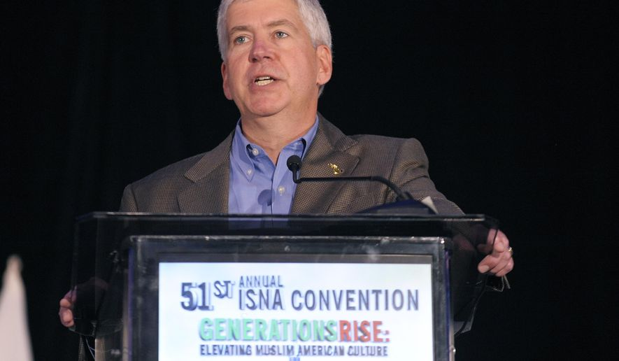 Gov. Rick Snyder speaks during the opening session of the Islamic Society of North America's 51st annual convention in Detroit on Friday, Aug. 29, 2014. (AP Photo/The Detroit News, Clarence Tabb Jr.)