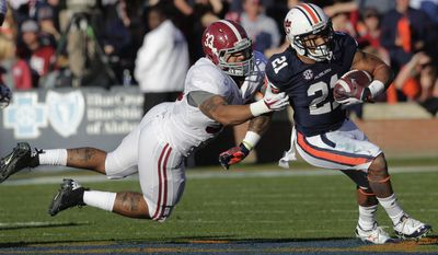 ALABAMA VS AUBURN - Auburn running back Tre Mason (21) is taken down by Alabama linebacker Trey DePriest (33) during the first half of an NCAA college football game in Auburn, Ala., Saturday, Nov. 30, 2013. (AP Photo/Dave Martin)