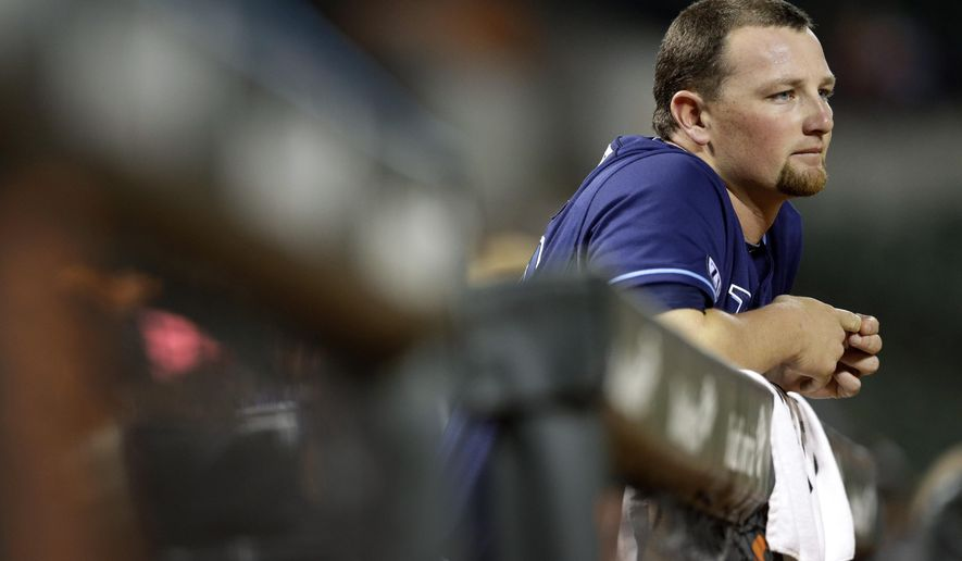 Tampa Bay Rays relief pitcher Kirby Yates watches from the dugout in the eighth inning of a baseball game against the Baltimore Orioles, Thursday, Aug. 28, 2014, in Baltimore. Yates was relieved in the seventh after Baltimore scored the go-ahead run. Baltimore won 5-4. (AP Photo/Patrick Semansky)