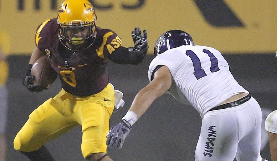 Arizona State running back D.J. Foster stiff-arms Weber State linebacker Luke King (11) during the first half of an NCAA college football game, Thursday, Aug. 28, 2014, in Tempe, Ariz. (AP Photo/Matt York)