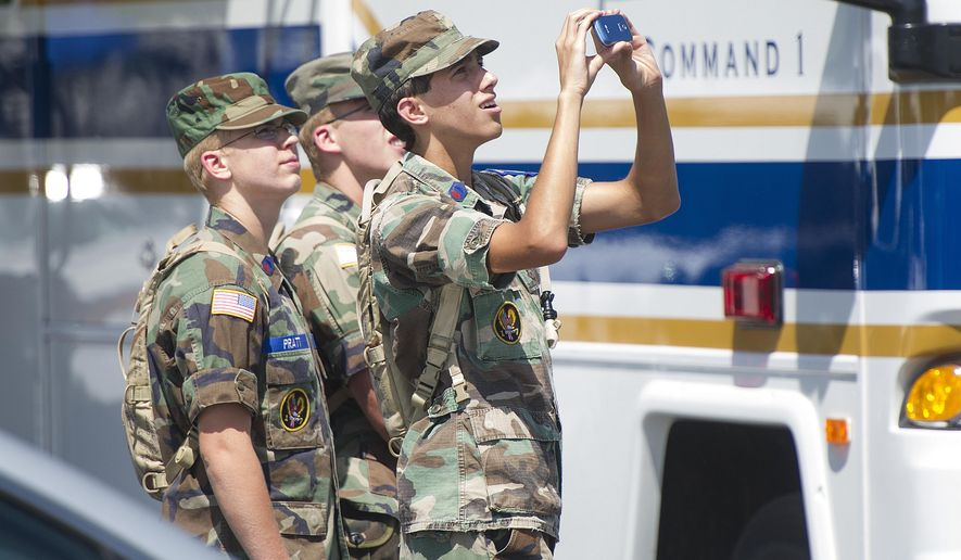 Young members of the Civil Air Patrol watch a search helicopter take of at the Deerfield Valley Volunteer Fire Department in Deerfield on Thursday, Aug. 28, 2014 in Deerfield, Va. The pilot of an F-15 jet that crashed this week in remote Virginia mountains was killed, military officials said Thursday, bringing to a sad end an exhaustive two-day search involving more than 100 local, state and federal officials as well as volunteers.  (AP Photo/The Staunton News Leader, Griffin Moores)