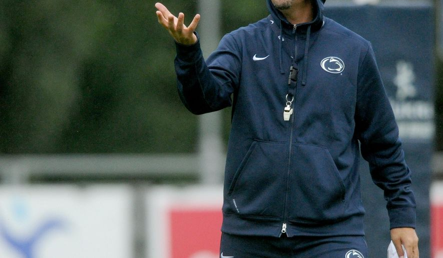 Penn State football coach James Franklin runs his team through practice at University College, in Dublin, on Wednesday, Aug. 27, 2014.  Jason Plotkin - Daily Record/Sunday News (AP Photo/York Daily Record,Jason Plootkin )  YORK DISPATCH OUT