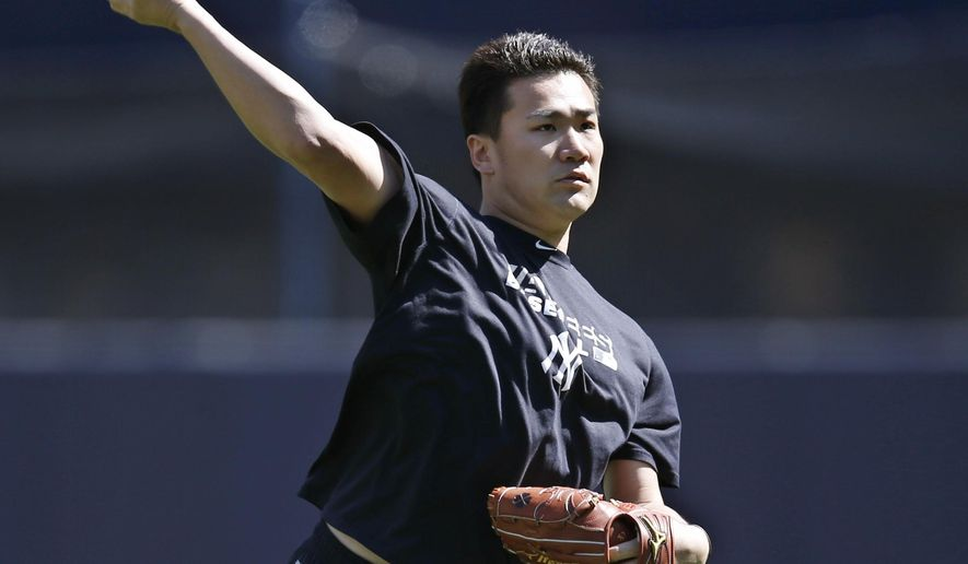 New York Yankees starting pitcher Masahiro Tanaka, who is on the disabled list, throws before a baseball game against the Chicago White Sox at Yankee Stadium in New York, Sunday, Aug. 24, 2014. (AP Photo/Kathy Willens)
