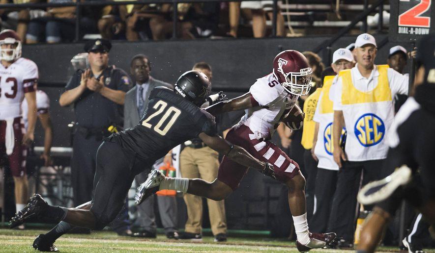 Temple's Jalen Fitzpatrick stiff-arm's Vanderbilt's Oren Burks on his way to a touchdown during the second quarter of an NCAA college football game Thursday, Aug. 28, 2014, in Nashville, Tenn. (AP Photo/Brian Powers)