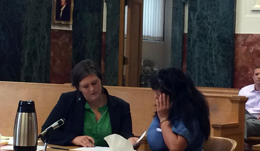 In this undated photo, defense attorney Kasia Rutledge, left, goes over the final details of a plea deal with Mattie Spino in Multnomah County Circuit Court in Portland, Ore. Spino who was sentenced in August 2014 to a five-year prison term for the crash that killed her daughter, was released from jail briefly to say goodbye to dying son. (AP Photo/The Oregonian, Aimee Green)  MAGS OUT; TV OUT; LOCAL TELEVISION OUT; LOCAL INTERNET OUT; THE MERCURY OUT; WILLAMETTE WEEK OUT; PAMPLIN MEDIA GROUP OUT