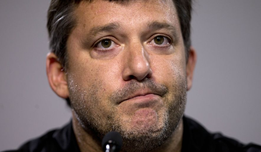 "NASCAR auto racing driver Tony Stewart reads a statement during a news conference at Atlanta Motor Speedway in Hampton, Ga., Friday, Aug. 29, 2014. Stewart says the death of Kevin Ward Jr. will ""affect my life forever"" as he returned to the track for the first time since his car struck and killed the fellow driver during a sprint-car race in New York. (AP Photo/John Bazemore)"