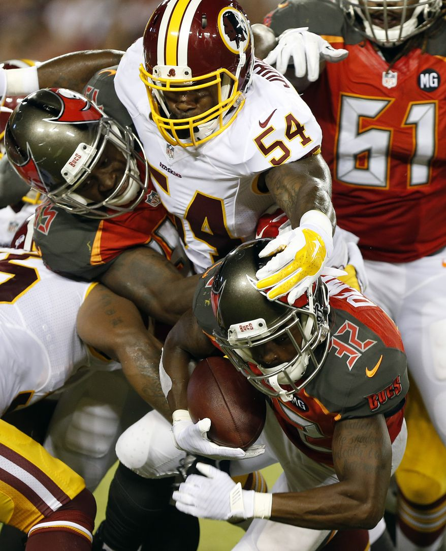 Washington Redskins inside linebacker Akeem Jordan (54) stops Tampa Bay Buccaneers running back Jeff Demps (32) during the second quarter of an NFL preseason football game Thursday, Aug. 28, 2014, in Tampa, Fla. (AP Photo/Brian Blanco)