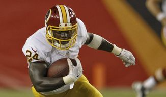 Washington Redskins running back Silas Redd carries the ball against the Tampa Bay Buccaneers during a NFL preseason football game Thursday, Aug. 28, 2014 in Tampa, Fla. (AP Photo/Steve Nesius)