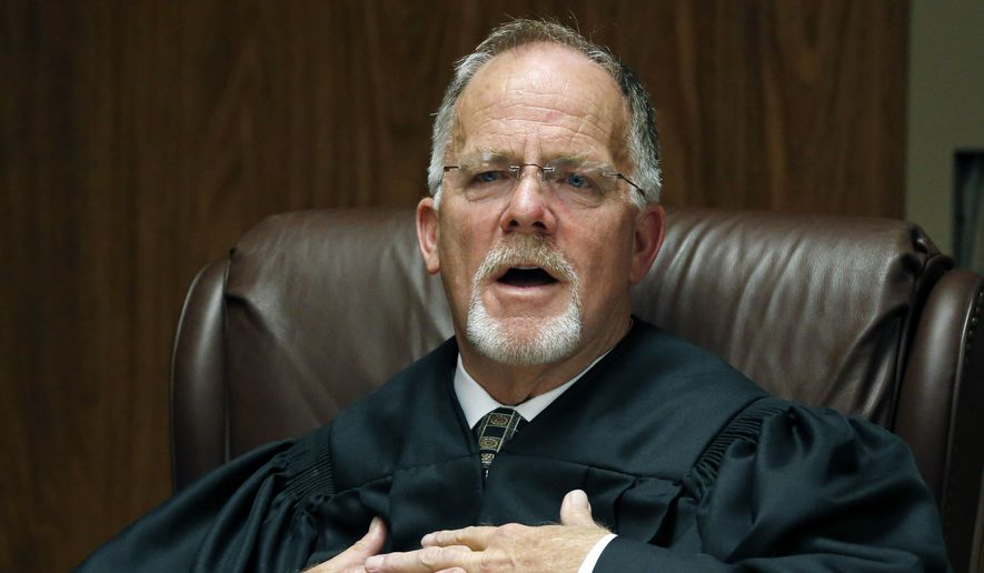 Judge Hollis McGehee offers a bench opinion as to why he dismissed a lawsuit that sought to overturn six-term U.S. Sen. Thad Cochran's victory in a Republican primary runoff, Friday, Aug. 29, 2014 in Gulfport, Miss.  McGehee dismissed a lawsuit on Friday, that sought to overturn Sen. Thad Cochran's victory in a Republican primary runoff saying that state Sen. Chris McDaniel, who lost to Cochran, failed to start the election challenge on time. McDaniel will announce Tuesday whether he will appeal the ruling to the Mississippi Supreme Court. (AP Photo/Rogelio V. Solis)