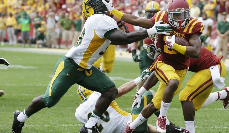 Iowa State running back Aaron Wimberly, right, breaks a tackle by North Dakota State linebacker Carlton Littlejohn, left, during a 16-yard touchdown run in the first half of an NCAA college football game, Saturday, Aug. 30, 2014, in Ames, Iowa. (AP Photo/Charlie Neibergall)