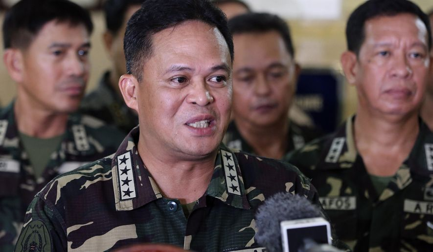 Philippine military chief Gen. Gregorio Pio Catapang answers questions from reporters about the situation of Filipino peacekeepers in Golan Heights, during a press conference at Camp Aguinaldo military headquarters in suburban Quezon city, Philippines on Sunday Aug. 31, 2014.Catapang said more than 70 Filipino peacekeepers have escaped from two areas in the Golan Heights that came under attack by Syrian rebels.  (AP Photo/Aaron Favila)